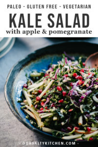 This kale pomegranate salad with brussels sprouts, fennel, apple is a bright, healthy and nutritious salad recipe! It's sweet, crunchy, and full of gorgeous color. Ready in just about 30 minutes, this is one of our go-to paleo side dish or salad recipes for cool weather. Options for paleo, Whole30 and vegan vinaigrette make this a super flexible winter salad recipe.