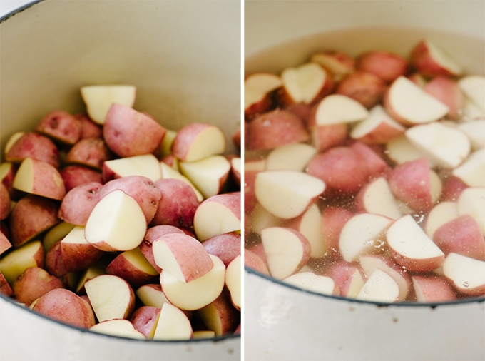 Quartered new potatoes in a large pot covered with water.