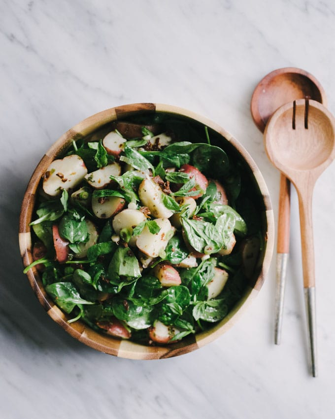 This no mayo potato salad with basil vinaigrette is a deeply flavorful, nutrition packed side dish. It's a naturally vegan and gluten-free whole food recipe, making it the quintessential summer party crowd-pleaser. #vegan #vegetarian #glutenfree #wholefood #realfood #nomayo #potatosalad