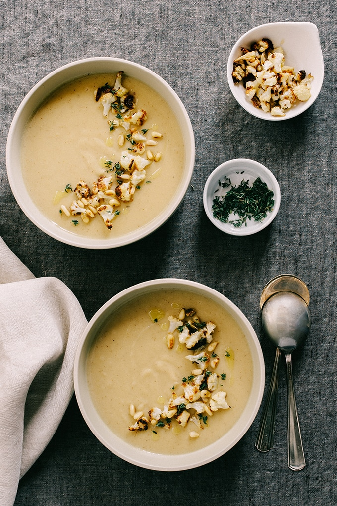 This roasted garlic cauliflower soup is nutty and slightly sweet, with hints of bright flavor from the thyme and olive oil. Naturally grain-free and gluten-free, it's also friendly for vegetarian, paleo, and whole 30 diets. This soup freezes well for an fast and easy weeknight meal or lunch.