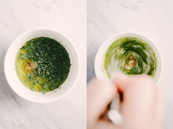 How to make herb vinaigrette for a sprouted lentil salad. Left - champagne vinegar, mustard, and herbs in a small bowl. Right - a woman's hand whisking olive oil into the vinaigrette.