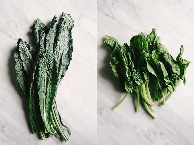 Left - raw kale greens on a marble background. Right - raw spinach greens on a marble background.