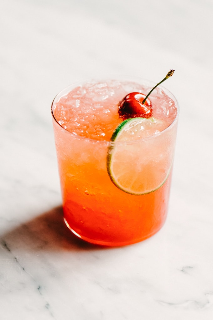 This Cherry Gin Rickey is liquid summer. It's a tart and refreshing summer gin cocktail with the perfect amount of sweet. You can easily make a large batch, so grab a few friends and get your rickey on.