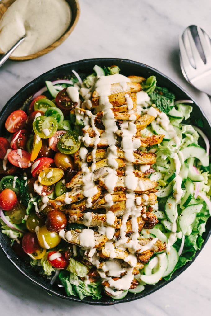 This recipe for chicken shawarma salad is a flavorful, fresh, easy weeknight dinner. Each bite is crisp, bright, and bursting with flavor. This is the perfect whole food summer weeknight dinner recipe! #healthy #wholefood #realfood #eatclean