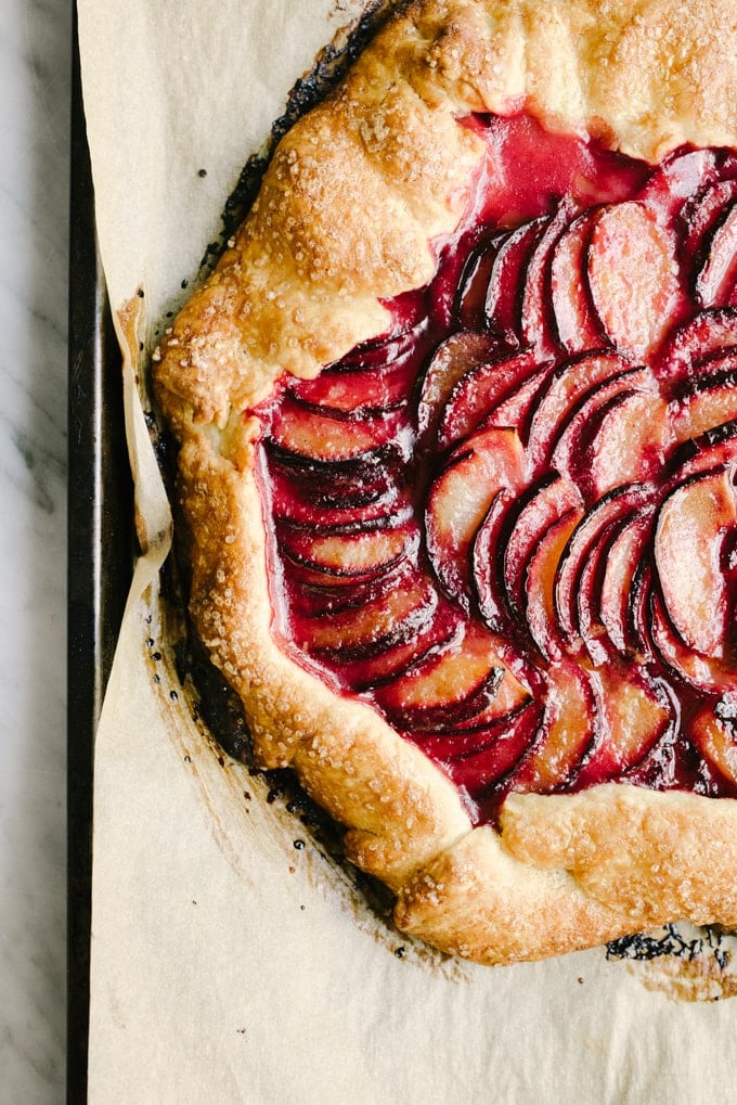 This cardamom plum galette is subtlety spiced, delightfully sweet, and a perfect use for the bounty of stone fruits available in late summer. The sweet cornmeal crust is crisp, yet delicate, with a melt-in-your-mouth tenderness.