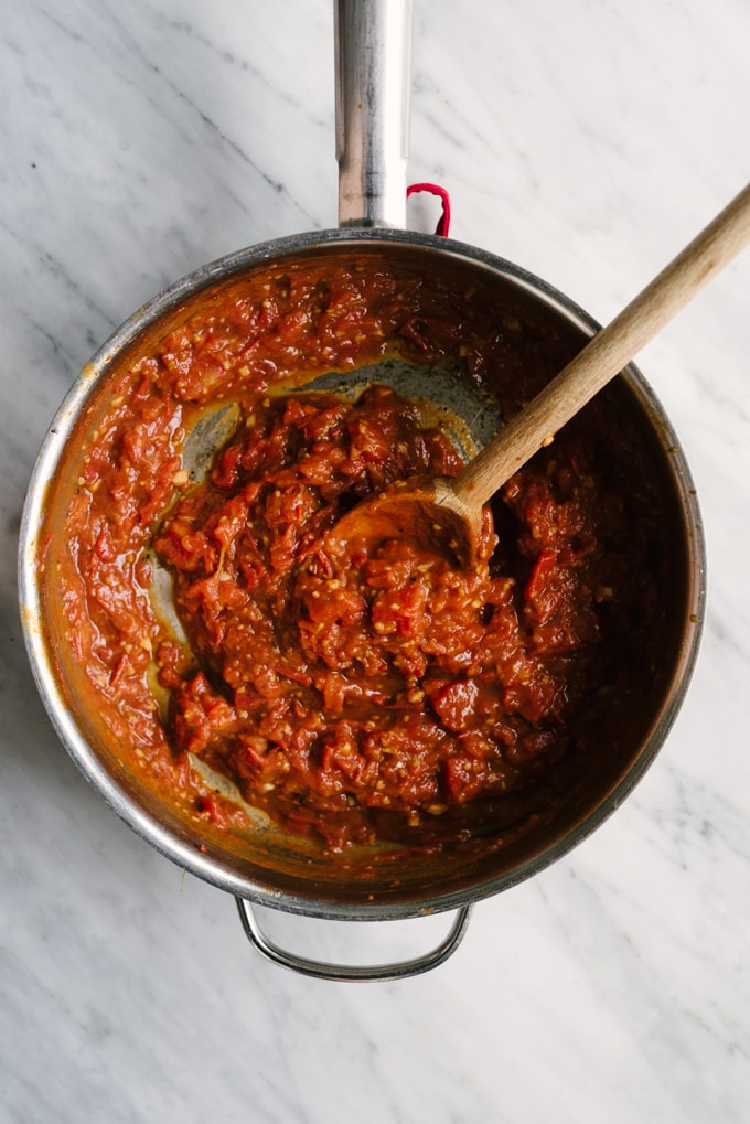 Fresh tomato marinara is a whole food recipe that never goes out of style. Deeply flavorful, stupid easy, and incredibly versatile, it's a recipe that every real food chef should master. #realfood #wholefood #tomatoes #marinara