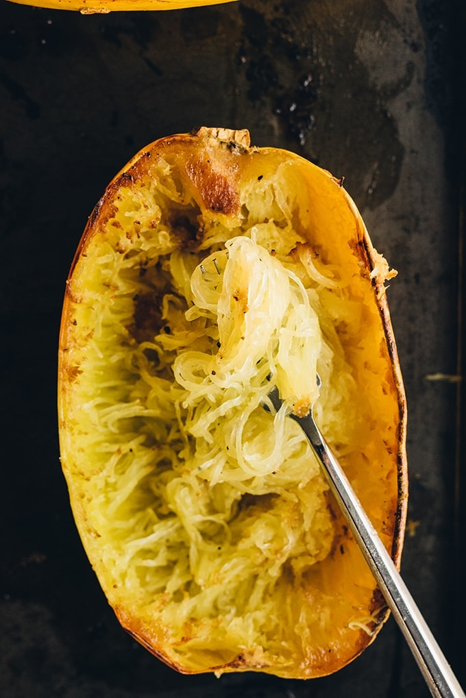 How to roast spaghetti squash. Caramelized and roasted spaghetti squash, raked and ready to be served with crockpot bolognese. An easy, gluten free pasta substitute!