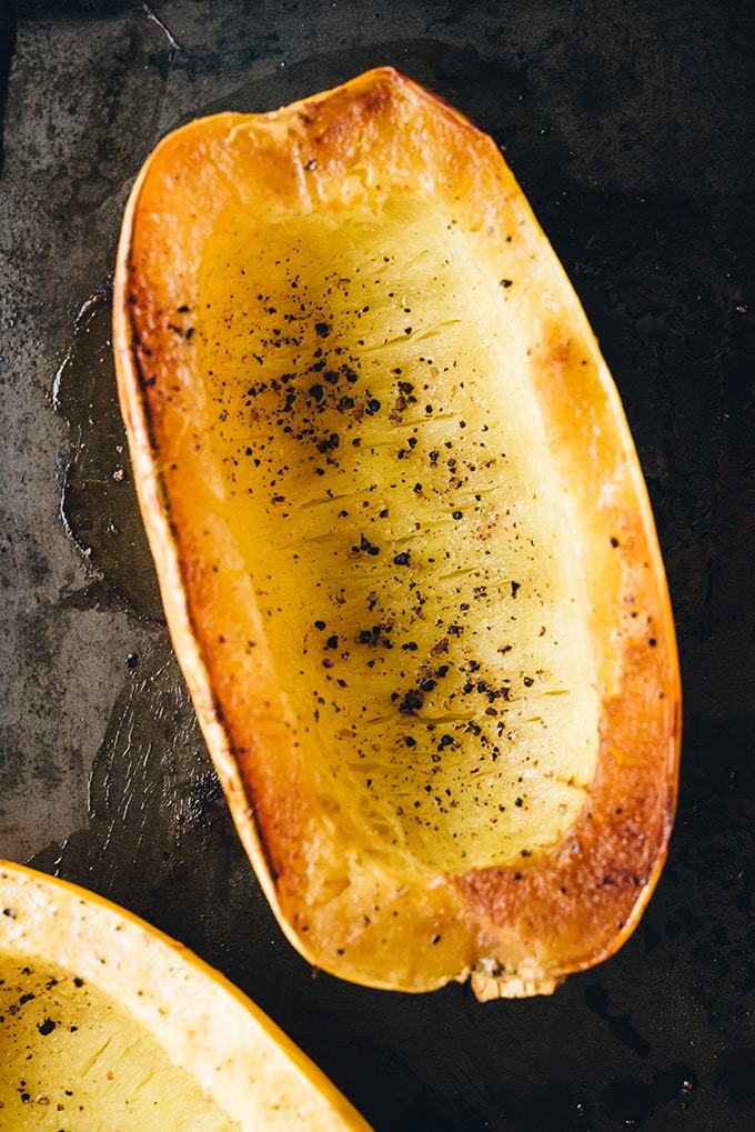 How to roast spaghetti squash. Caramelized and roasted spaghetti squash fresh from the oven. Ready to be raked and served with crockpot bolognese. An easy, gluten free pasta substitute!