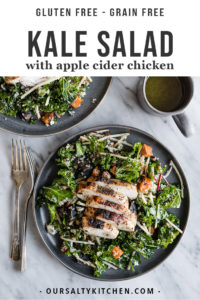 A plate of kale chicken salad with apples, quinoa, and maple vinaigrette.