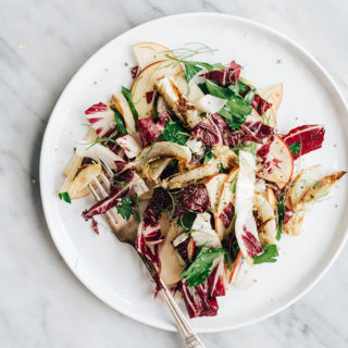 This roasted fennel salad is a bright, flavorful, nutty and nutritious cool weather recipe. It's a perfect quick lunch, or colorful Thanksgiving side dish.