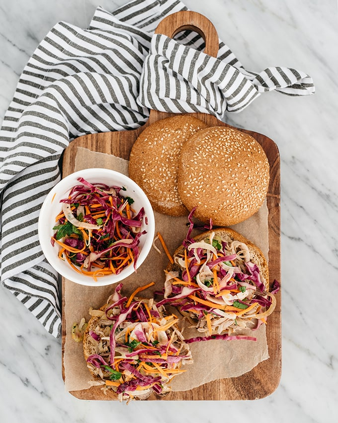 This slow cooker version of apple cider pulled pork is an easy, kid friendly recipe for fall. It's gluten free, sweet and savory, and pairs perfectly with an apple cider vinegar slaw. We love it in a pulled pork sandwich and save the leftovers for quick and easy lunch prep salads. #glutenfree #applecider #pulledpork #recipe #crockpot