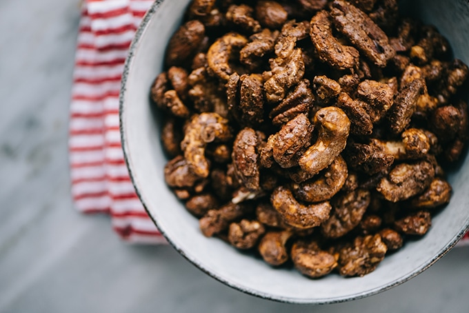 Spice up your holiday party with these irresistibly seasonal gingerbread spiced nuts! They're an easy, make-ahead, crowd pleasing holiday appetizer or cocktail party snack. They're paleo, refined sugar free, require just 15 minutes of prep, and can be completely prepared in advance. #paleo #appetizer #snack #gingerbread #spicednuts