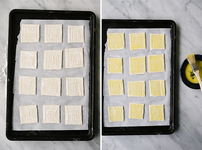 Squares of puff pastry on a baking sheet, scored and docked, ready to be filled with butternut squash, caramelized onions, and ricotta cheese.