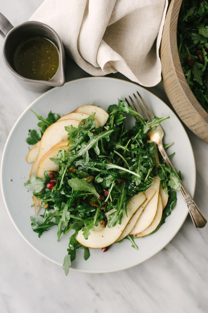 Arugula pear salad with pistachios and pomegranate our salty kitchen this arugula pear salad is a satisfying whole food recipe thats ready in mere minutes forumfinder Image collections
