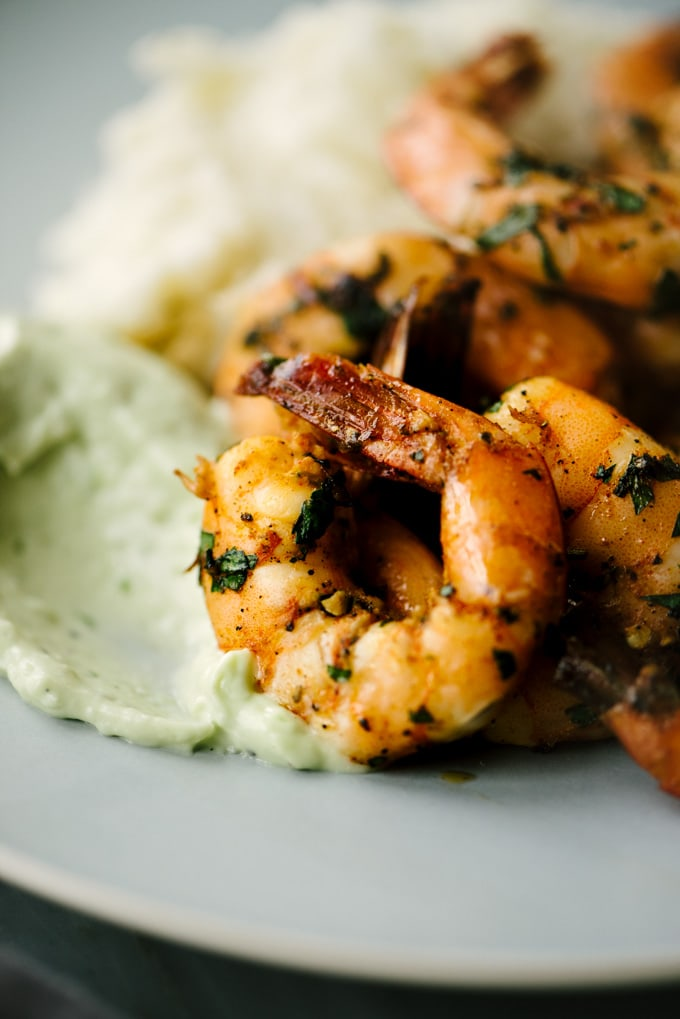 This paleo spicy shrimp is an easy and fast weeknight dinner recipe. The shrimp are hot and tangy, and pair so well with tart, creamy avocado aioli. This tasty paleo shrimp recipe is perfect for January Whole30 - or any other night! #paleo #whole30 #shrimp #spicyshrimp #recipe #30minutemeal