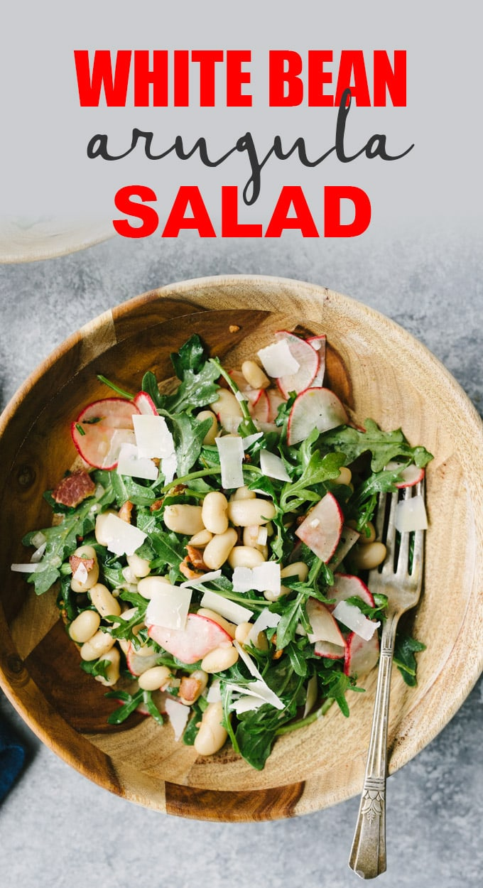 This white bean salad with bacon and arugula is a bold and tangy gluten free dinner salad. It's easy and healthy, and ready in less than 30 minutes. #whitebeans #glutenfree #bacon #quickandeasy #recipe #grainfree #realfood #wholefoods