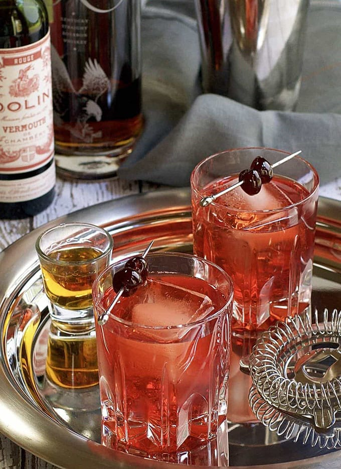 Two glasses of the Boulevardier - a classic winter bourbon cocktail recipe.