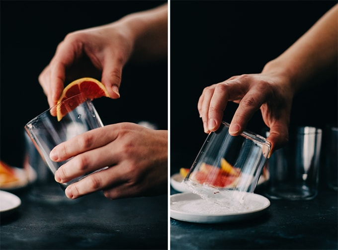 How to make a paloma cocktail. Left, a woman running a grapefruit wedge around the rim of a cocktail glass. Right, dipping the edge of the cocktail glass in a small dish of kosher salt.