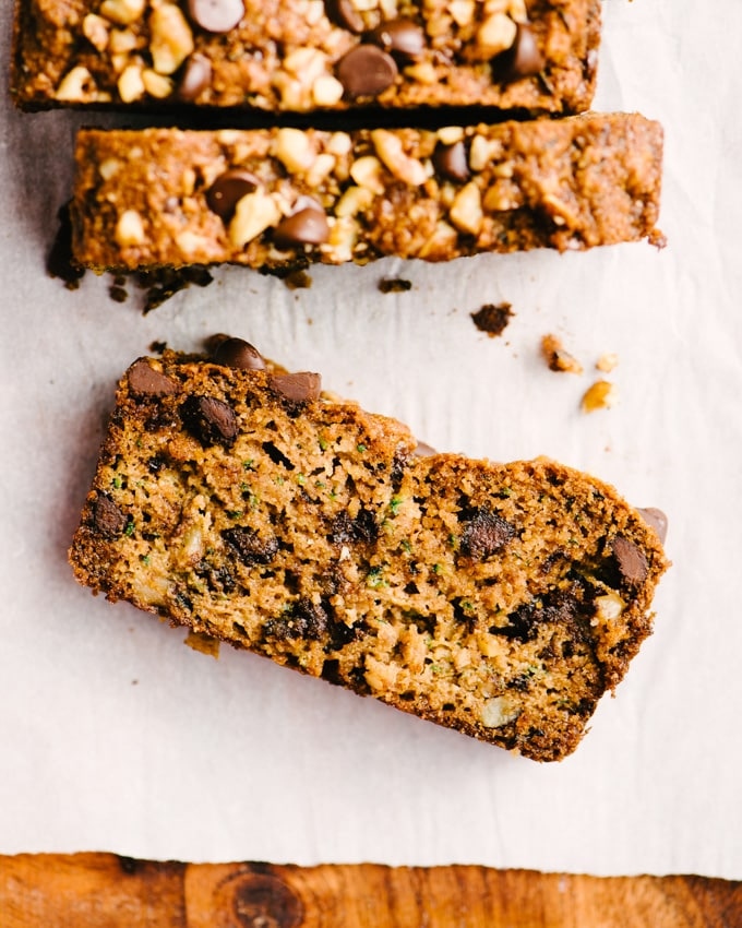 An overview image of a single slice of paleo zucchini bread with walnuts and chocolate chips.