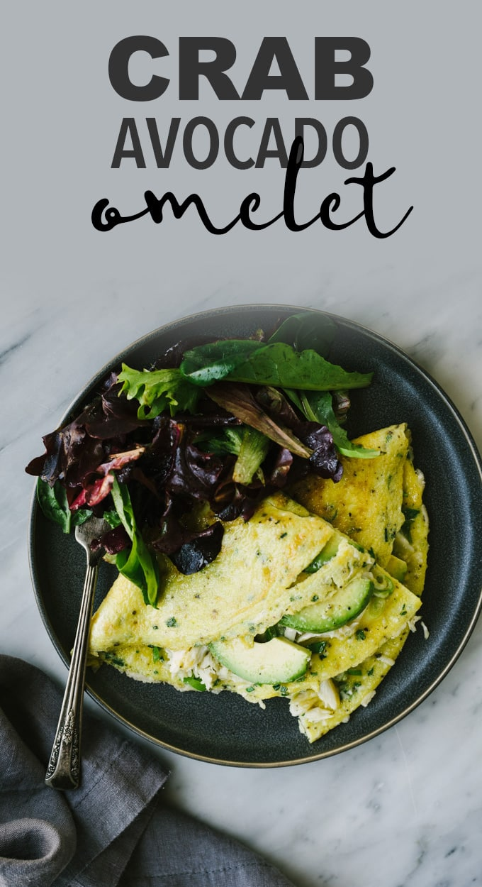 This three egg crab omelet with avocado and fresh herbs is a fancy but fuss free brunch recipe that's perfect for Mother's Day! It's ready in just fifteen minutes and so easy to make. Serve it with a simple green salad for brunch, or on its own for a fast, protein packed weekday breakfast. #omelet #crab #mothersday #brunch #eggs #avocado #breakfast