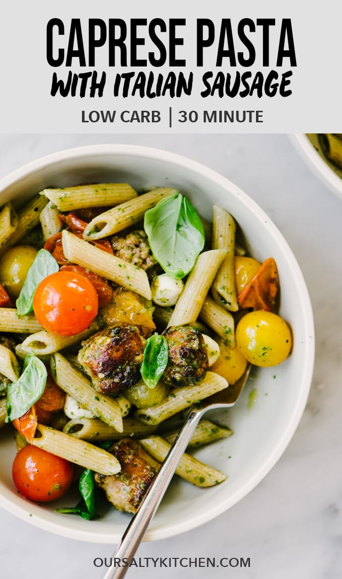 This caprese pasta with whole wheat penne and Italian sausage is a protein packed, lighter twist on the classic. It's got just enough pasta to satisfy a craving but still be considered low carb. This easy summer pasta recipe is dressed with a clean basil pesto that's bright and intensely flavored. You'll love this healthy, clean summer dinner! #caprese #pasta #clean #lowcarb #wholewheat #healthy #summer