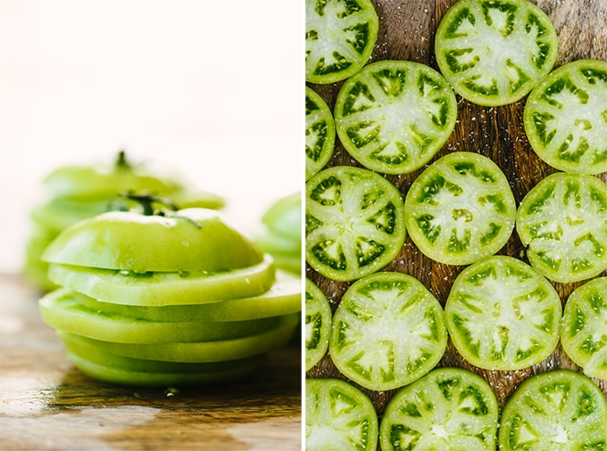 How to prep green tomatoes. Left, a stack of green tomato slices. Right, sliced of green tomatoes sprinkled with salt on a wood cutting board.