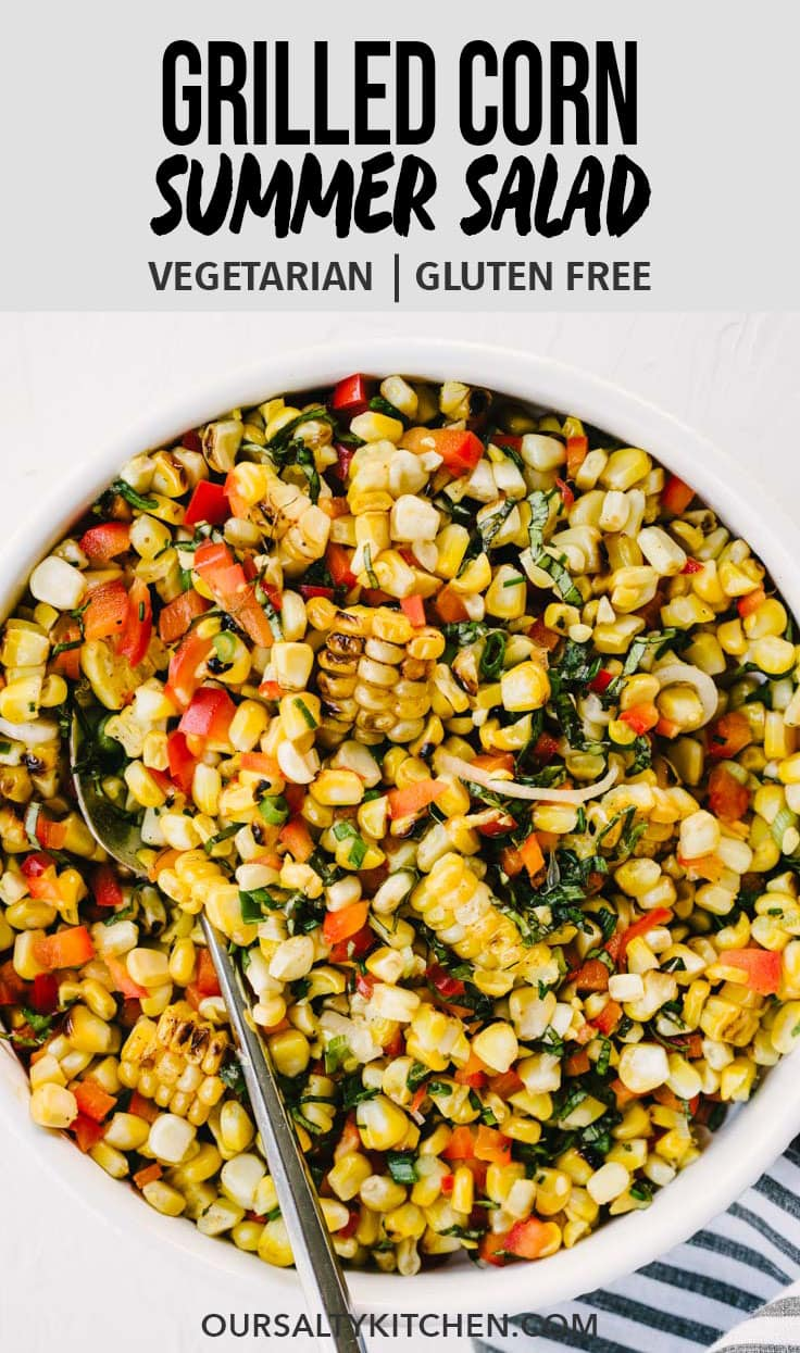 This simple grilled corn salad will be your go to side dish all summer long! It's an easy and healthy recipe that's perfect for picnics, pot lucks, summer parties, and more. This recipe comes together in just 30 minutes with smokey charcoal grilled corn, sweet bell peppers, thinly sliced green onions, tons of fresh basil, and a tangy lime dressing. #corn #salad #recipes #realfood #wholefood #grilling #glutenfree #vegetarian