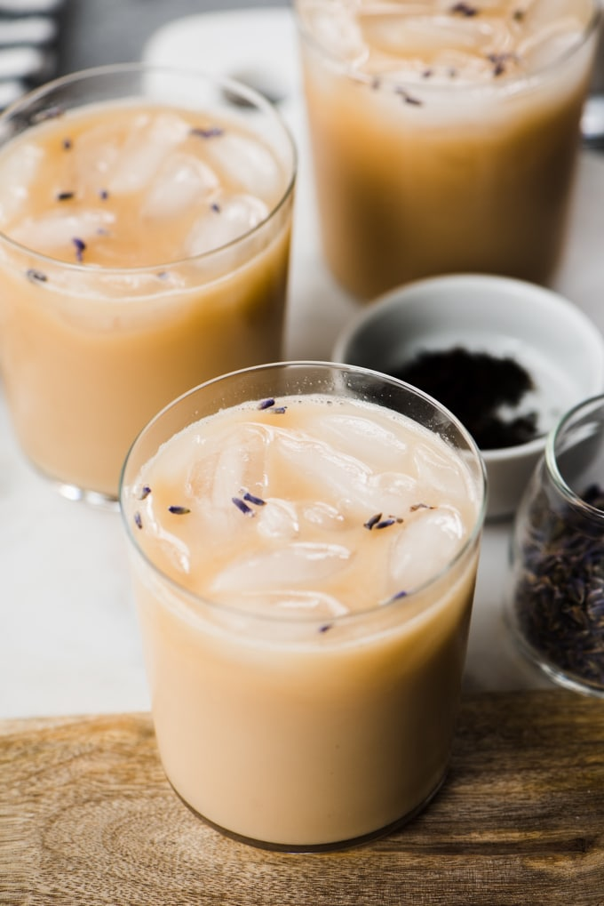 Three iced london fog tea lattes brewed with lavender and sweetened with vanilla extract, stevia, and cashew milk. A healthy, refreshing paleo iced tea latte!