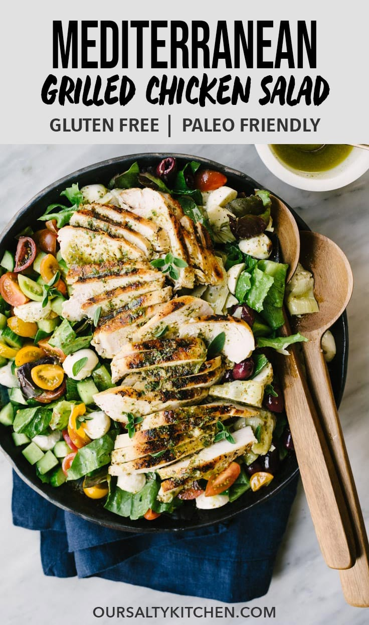 This grilled mediterranean chicken salad is the perfect summer meal for busy families! Chicken breasts are marinated in a lemon herb brine, then grilled and topped over a mediterranean salad with olives, artichoke hearts, and fresh mozzarella. It's an easy, healthy, gluten free dinner salad that's packed with bold flavor. #healthy #salad #summer #chickensalad #mediterranean #glutenfree #grainfree #dinnersalad
