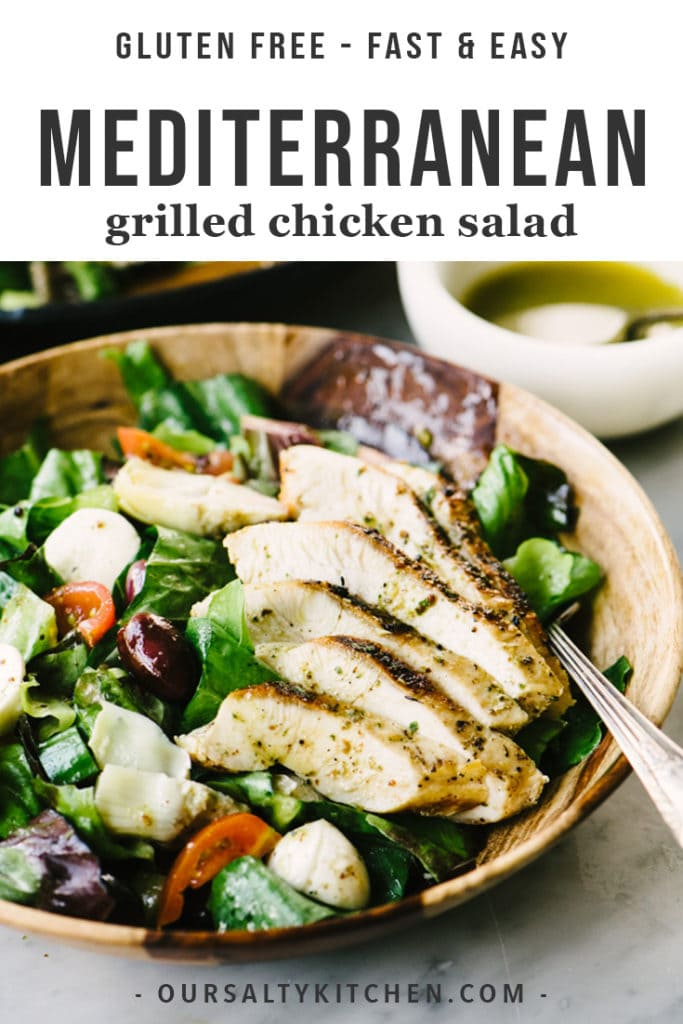 A bowl of gluten free mediterranean grilled chicken salad with olives, artichokes, and oregano vinaigrette.