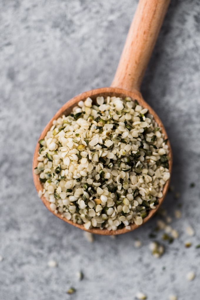 A small wooden spoon filled with protein packed hemp seeds.