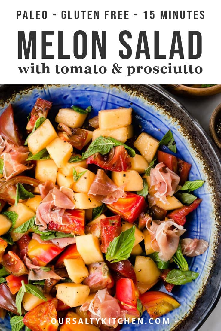 Summer melon salad with tomato and prosciutto in a large bowl garnished with basil and mint.