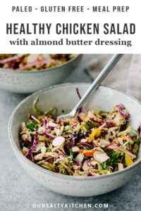 Skip the mayo and make this healthy protein packed chicken salad with almond butter dressing! This paleo and gluten free recipe is packed with fresh vegetables, crunchy nuts and seeds, and finished with a creamy, asian inspired almond butter dressing. This no mayo chicken salad is a great paleo, whole30, and gluten free meal prep recipe, and takes less than 30 minutes to make!