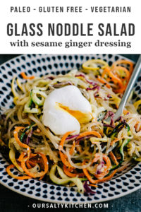 This rainbow glass noodle salad is perfect for back to school meal prep! Sweet potato glass noodles are tossed with zucchini, squash, carrots, cabbage, and an Asian inspired sesame ginger dressing. Serve it cold or warm, for lunch or dinner, with a poached egg, shrimp, or chicken. Whether you're paleo, gluten free, grain free, low carb, vegetarian, or something else, you'll go crazy for this easy, healthy noodle salad!