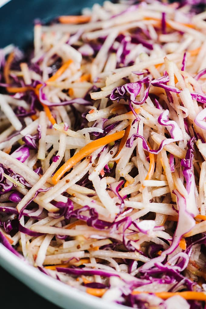 Apple jicama slaw with carrots and red cabbage.