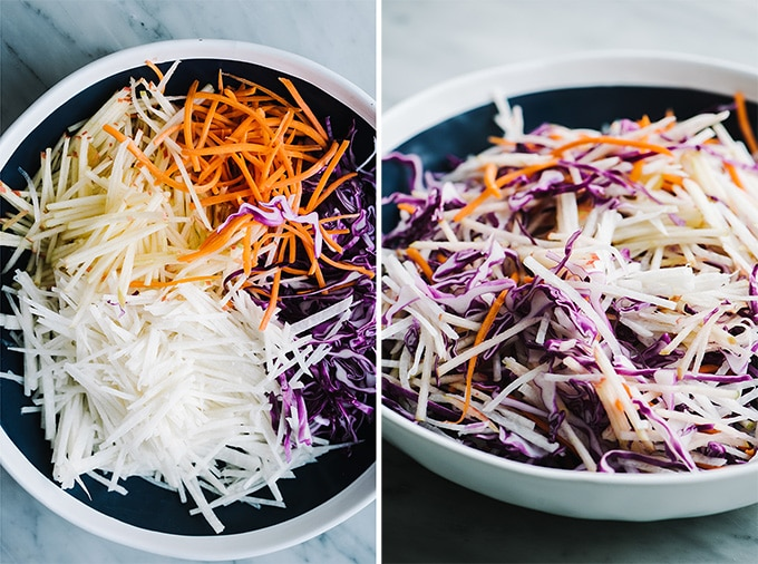 Apple jicama coleslaw in a blue and white serving bowl.