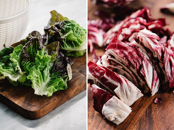 Butter lettuce leaves on a cutting board; chopped radicchio on a cutting board.