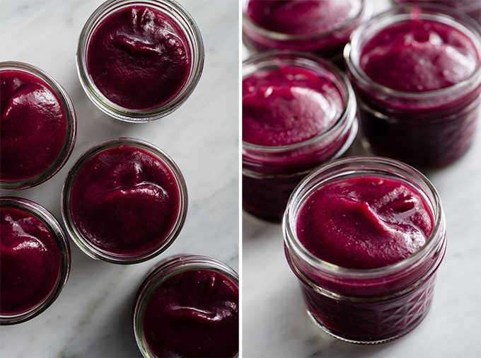 Smooth vanilla infused blueberry applesauce in small glass jars.