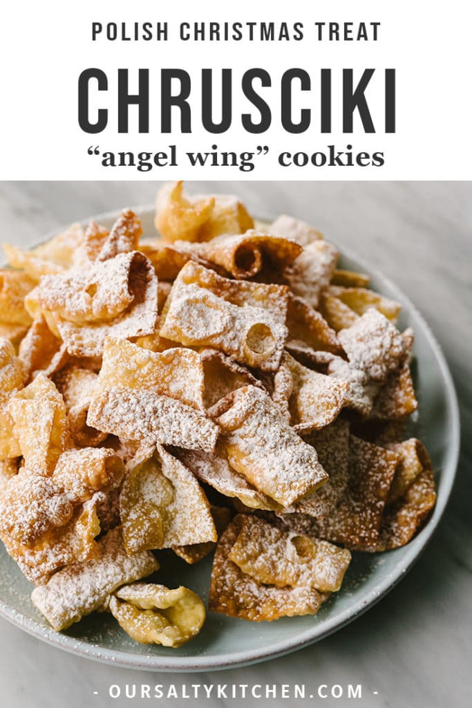 A plate of polish Polish chrusciki (angel wings) dusted with powdered sugar.