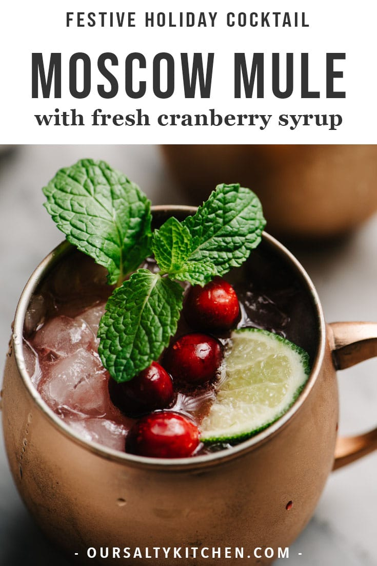 This cranberry moscow mule is perfectly sweet-and-tart, festively hued, and a must-make seasonal cocktail for all of your holiday gatherings! Made with vodka, fresh lime juice, ginger beer, and a honey-sweetened fresh cranberry syrup, this easy winter cocktail recipe is beautiful, delicious, and and so easy to make! It's the perfect specialty cocktail recipes for holiday cocktail parties, Christmas brunch, and New Year's Eve. #cocktail #holiday #moscowmule #christmas
