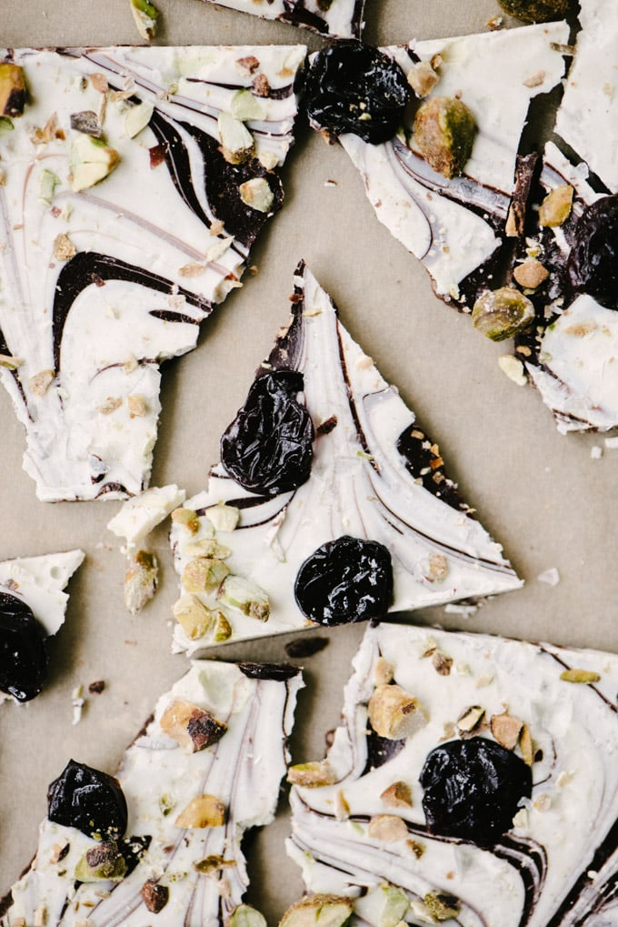 Pieces of homemade white and dark chocolate bark, the perfect edible Christmas gift this holiday season. gvc