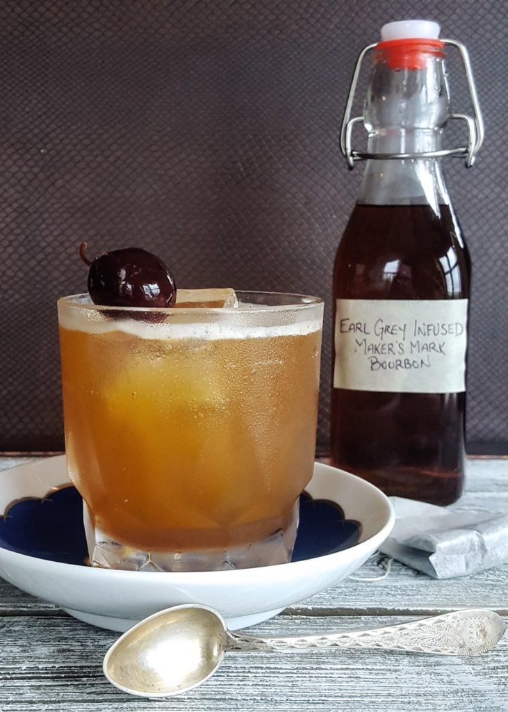 A cocktail made with homemade early grey tea infused bourbon - an easy and make ahead DIY Christmas gift!
