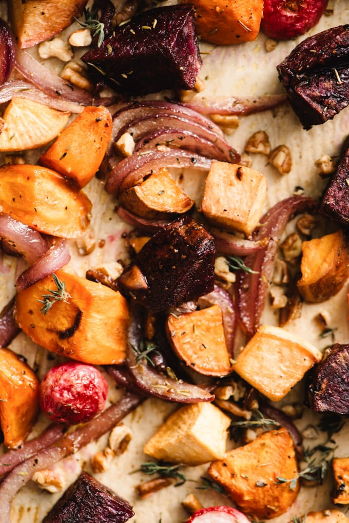 A close up view of maple roasted root vegetables on a baking sheet.