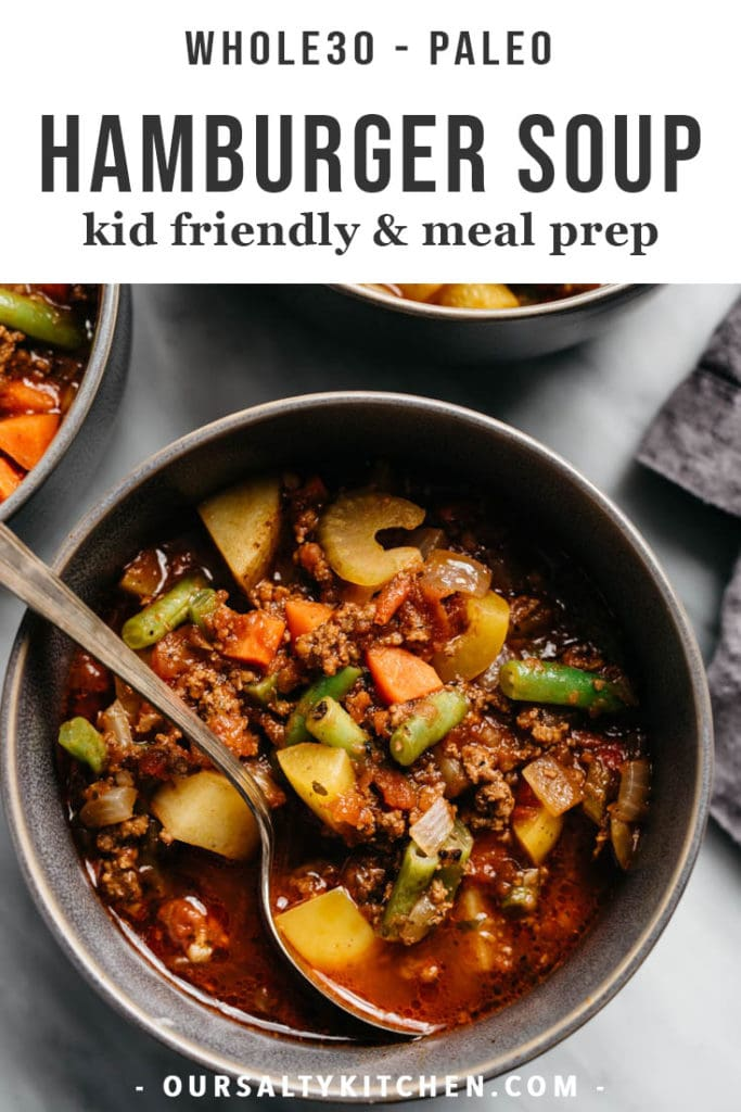 A bowl of hearty kid friendly whole30 hamburger soup in a grey bowl on a marble table.