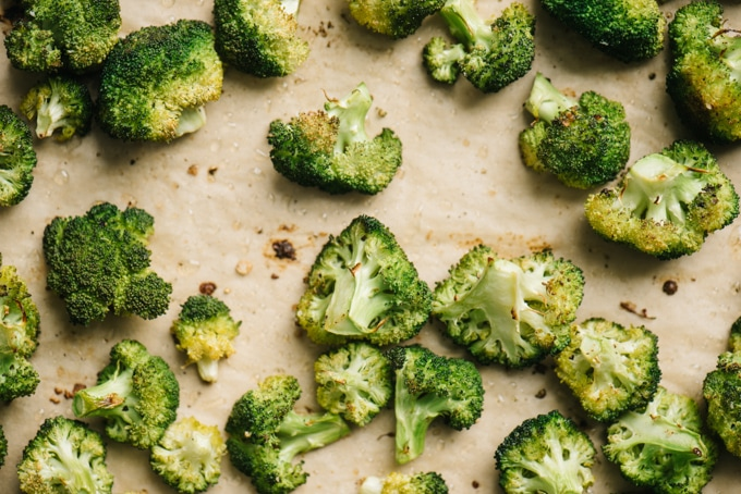Perfect oven roasted broccoli florets on a baking sheet.