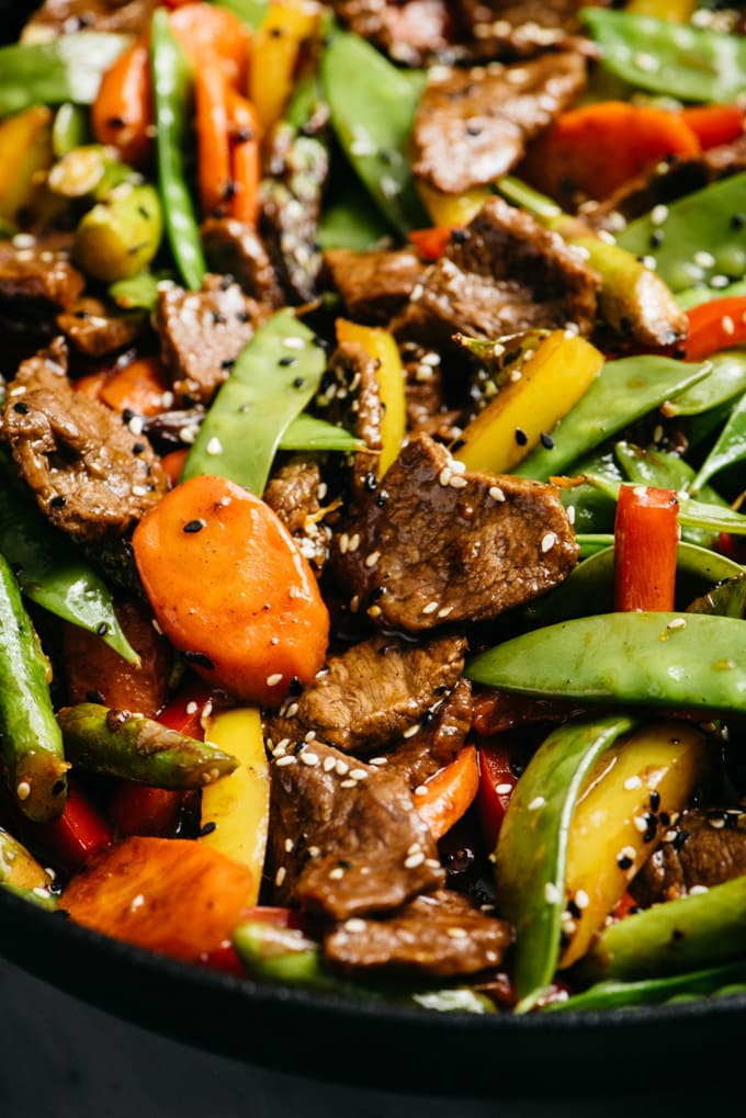 A close up image of stir fry steak with vegetables.