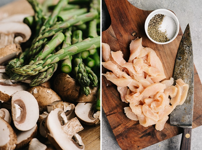Sliced asparagus, mushrooms, and raw chicken strips on cutting boards - the prep for chicken and asparagus skillet recipe.