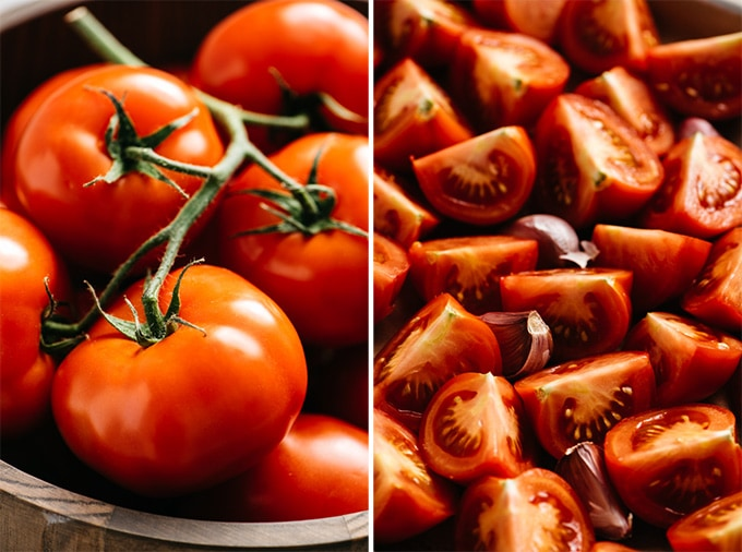 A bowl of fresh tomatoes on the vine, and quartered tomatoes on a baked sheet.