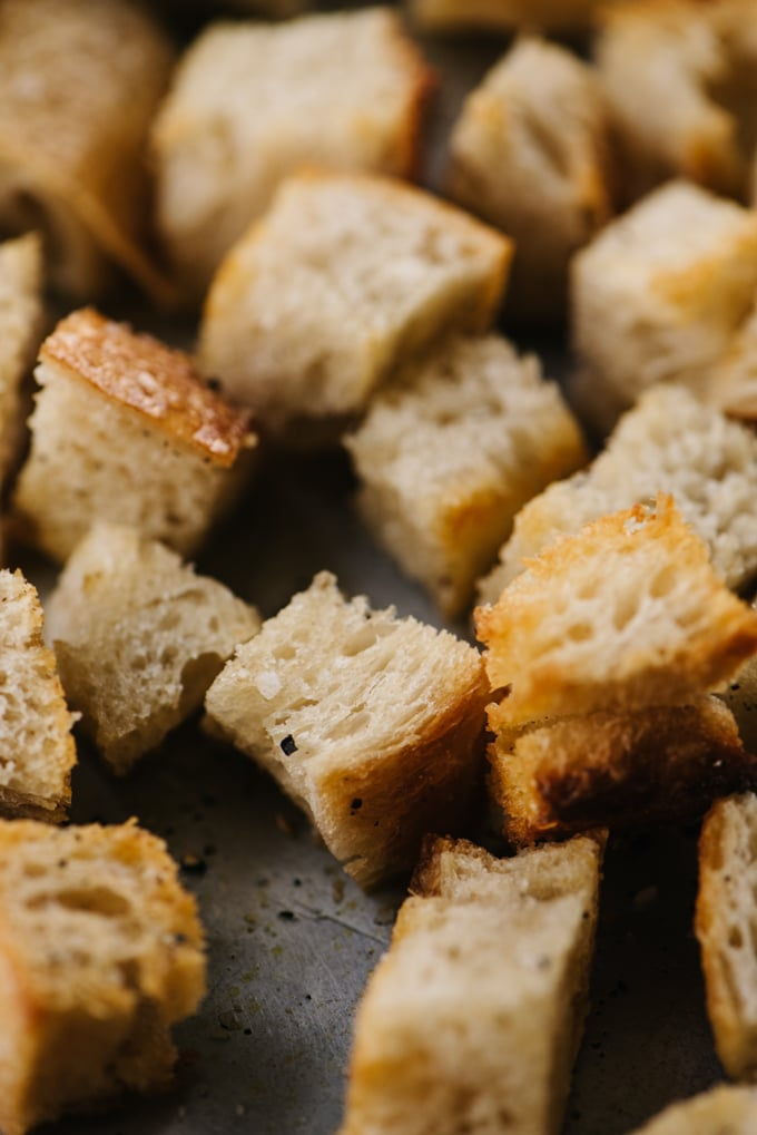 A close up view of oven baked sourdough croutons.