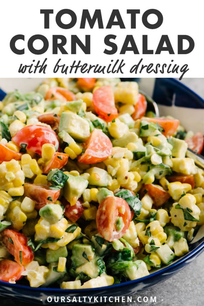 A blue and white bowl of tomato corn salad with avocado and buttermilk dressing and text bar at the top for Pinterest.